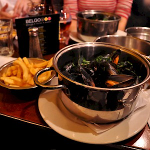 A pot of moules with frites (Photo by denAsuncioner)