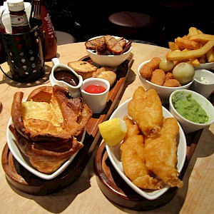 Fish and chips and meat pies are staples of British pub menus (Photo cormac70)