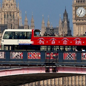 A hop-on/hop-off open-top double decker sightseeing bus crossing London Bridge (Photo © The Original London Sightseeing Tour Ltd 2016)