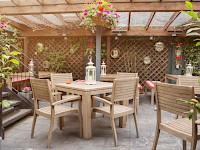 An outdoor seating area at the Malt House B&B, London