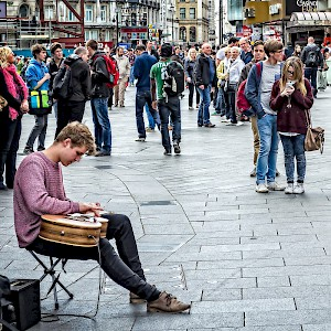 A lone busker entertains the passing crowds in Leicester Square (Photo by Garry Knight)