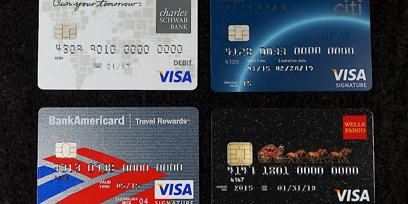 Four USA-issued chip-and-pin cards (Charles Schwab Bank Visa Debit Card, Citi ThankYou Preferred Visa Signature Credit Card, Bank of America BankAmericard Travel Rewards Visa, Wells Fargo Cash Bank Visa Signature Credit Card) (Photo by Aranami)