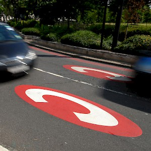 Road markings—like these on Kensington High Street—mark the Central Zone where the London Congestion Charge takes effect (Photo © Transport for London)