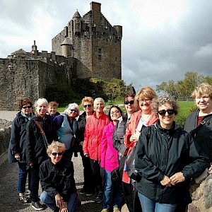 A Sights and Soul tour of Scotland in front of the 13C Eileen Donan castle (Photo courtesy of Sights and Soul)