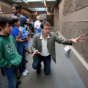 A University of London archaeologist, hired through Context Travel, guides a family through the British Museum in London (Photo courtesy of Context Travel)