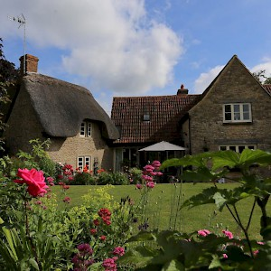 The 17C cottage and front garden (Photo courtesy of the property)